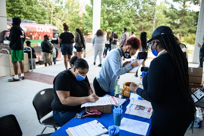Fayetteville City Council member Shakeyla Ingram, right, helps FSU students Brianna Hall, left, and Victoria Singleton register to vote during the HBCU Voters Day on Friday at Fayetteville State University.