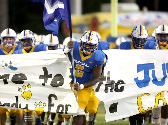 Newberry High football players run onto the field at the start of a recent game in Newberry.