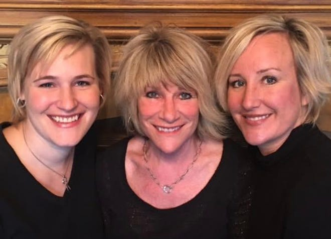 Trisha Gaumer (left), owner Judy Duff and Marla Morrison are ready to cut — and style — hair.