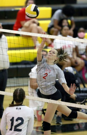 Bay's Aislyn White (2) hits the ball over the net. Rutherford faced off with Bay for a volleyball match on Oct. 1 at Rutherford.