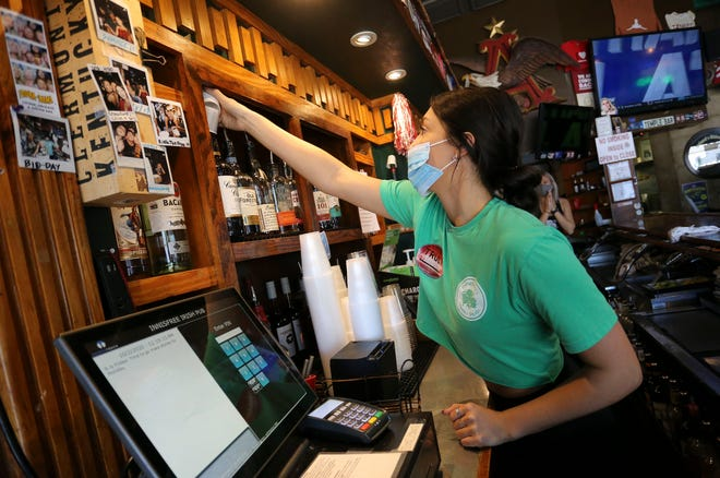 """Brittany Self works behind the bar at Innisfree Irish Pub on Friday, Oct. 2, 2020 in Tuscaloosa. Tuscaloosa-area restaurants, bars and hotels are in serious """"help wanted"""" mode, especially as football season approaches. [Staff Photo/Gary Cosby Jr.]"""