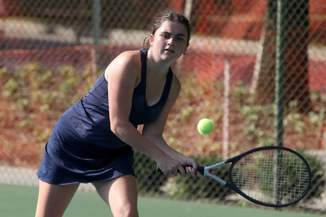 "Cate Stanley, a former soccer player, has worked her way up to the first-singles court for the Grandview Heights girls tennis team. ""Cate is always battling, and she never gives up,"" coach Kathy Kinnard said."