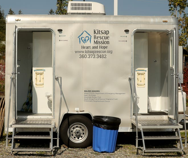 The mobile shower trailer at North Kitsap Fishline in Poulsbo offers showers for the homeless, and those who come will be given coins and supplies to launder their clothes.