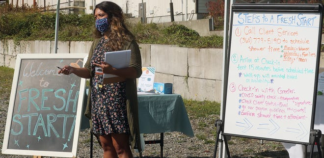 Lauren Beck, Fresh Start Coordinator, talks about the mobile shower program at North Kitsap Fishline in Poulsbo on Friday.