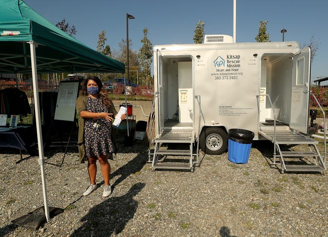Lauren Beck, Fresh Start Coordinator, talks about the mobile shower program at North Kitsap Fishline in Poulsbo. The program will offer showers three days a week with designated days for women, families and men.