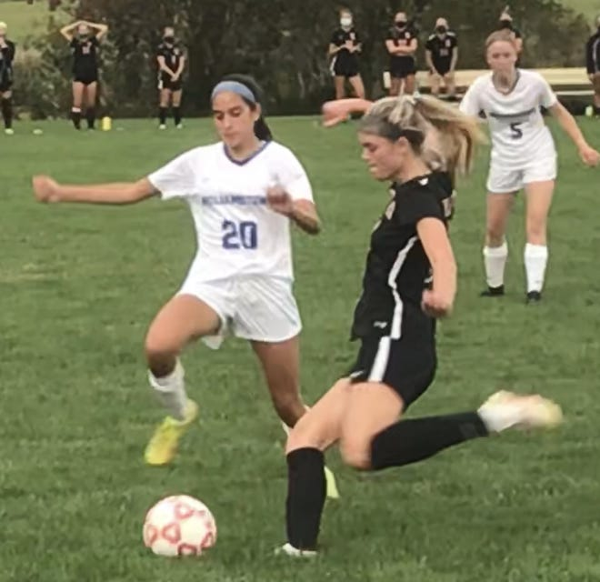 Kingsway's McKenna Williams gets ready to take a shot as Williamstown's Angela Oliveto defends during Thursday's season opener. Kingsway won, 2-1.