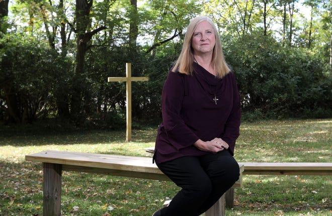 Rev. Deborah Bowsher at Trinity United Presbyterian Church's outdoor gathering place near the church in Zanesville.