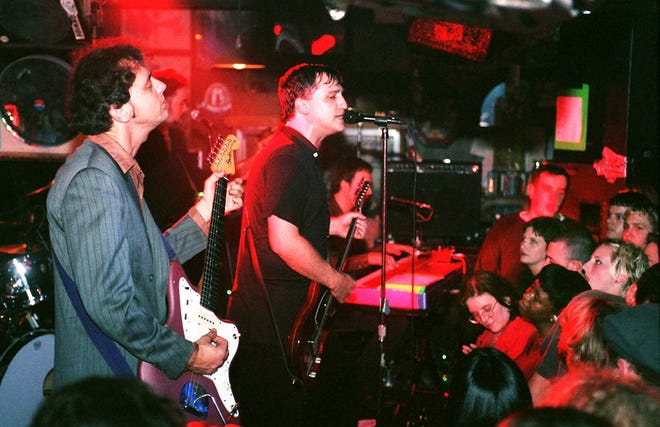 """1998: Afghan Whigs vocalist/guitarist Greg Dulli leads the band during a """"surprise"""" gig at Sudsy Malone's in Corryville. At left is guitarist Rick McCullum. In background is bassist John Curley."""