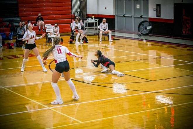 Coshocton's Miyah Davis goes low to the court after this dig in the first game of Thursday night's matchup with Meadowbrook.