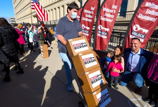 Boxes filled with a reported 539,384 petition signatures are delivered by Unlock Michigan to the Michigan Department of State Bureau of Elections in Lansing Friday, October 2, 2020. The group is seeking to revoke Governor Gretchen Whitmer's ability to govern by emergency decree.