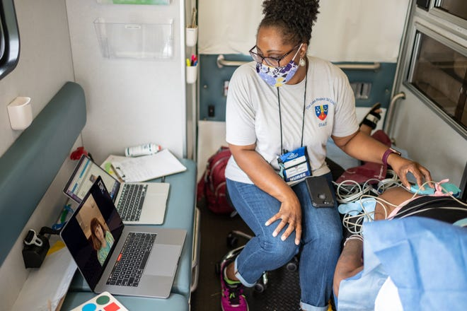 Nurse Tiffany Burrell tends to a patient in the  Luke Clinic's mobile facility