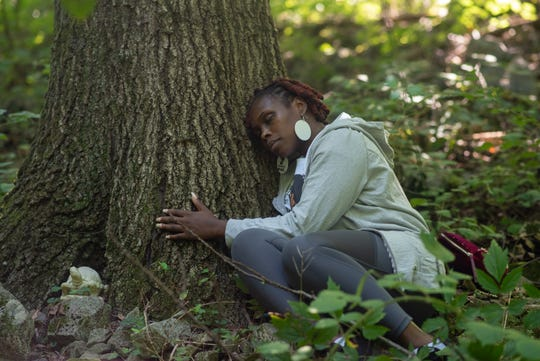 Natasha Glaude, a participant in a recent forest-bathing event, takes a moment to savor the natural world.  Natasha Glaude August 2020 by