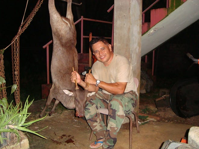 In this file photo, John Borja shows off a freshly hunted deer.