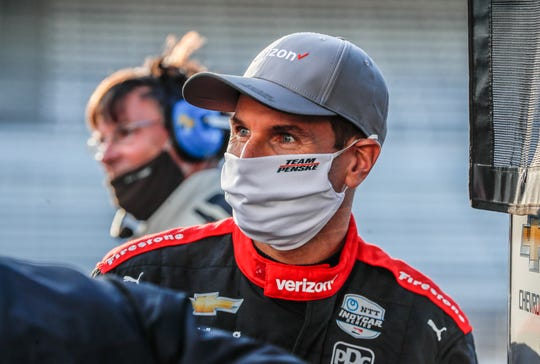 IndyCar driver Will Power wears a mask in the pits during qualifying for the IndyCar Harvest GP at the Indianapolis Motor Speedway, Thursday, October 1, 2020.