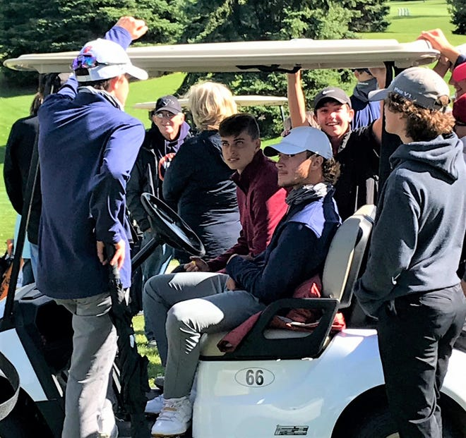 Sectional medalist Spencer Keller of Galion (seated with a cap on) shares a golf cart with good friend Lincoln Finnegan of Shelby while surrounded by players from both schools after their teams advanced to next week's district tournament at Findlay Country Club