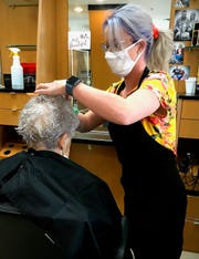 Hair stylist Kaitlin Rice works on a client's hair at The Art of Style Hair Studio in Marion. Rice became the owner of the salon in March.