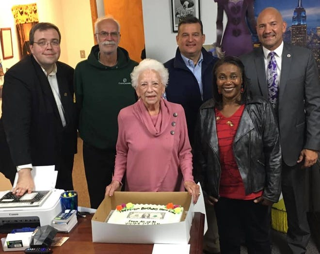 Mary Ellen Withrow, center, poses with WWGH-FM radio host Scott Spears, WZMO-FM radio host Jeff Ruth, Marion Mayor Scott Schertzer, WWGH-FM radio host Linda Sims and Marion City Schools superintendent Ron Iarussi.
