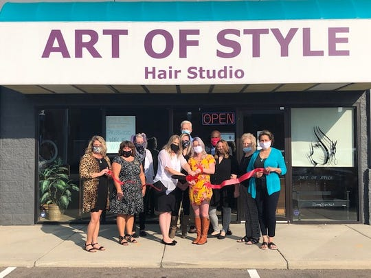 Kaitlin Rice, center, celebrates the ribbon-cutting of her salon, The Art of Style Hair Studio, with the Marion Area Chamber of Commerce Sept. 24. Rice became the new owner of the salon in March.