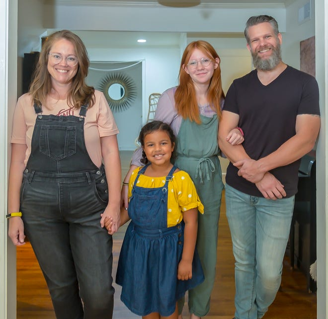 Jen, Posie, Harper and Chris Steinmetz love their new home.
