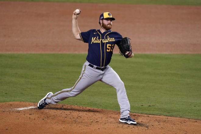 Brewers starter Brandon Woodruff qualified early for arbitration.
