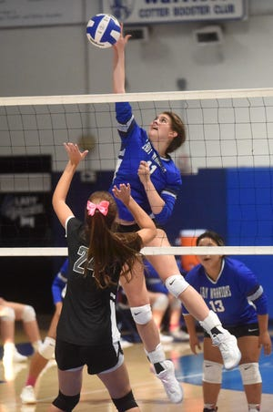 Cotter's Kate Cheek skies for a kill during the Lady Warriors' victory over Izard County on Thursday night.