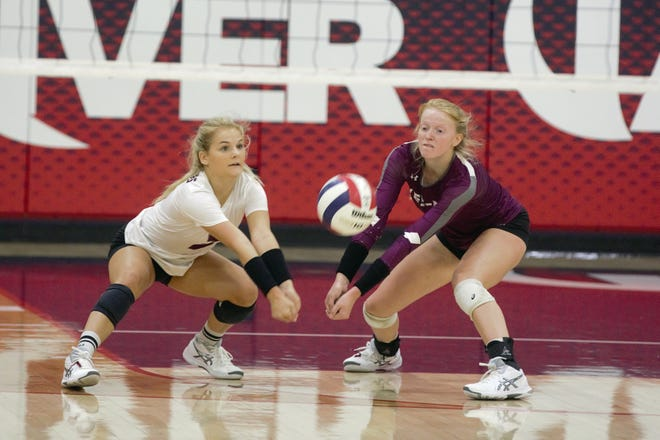FILE -- Wes-Del's Cassy Wilson (left) and Kylie Antrim (right) go for a ball during a match against Blue River Saturday, Sept. 26, 2020.