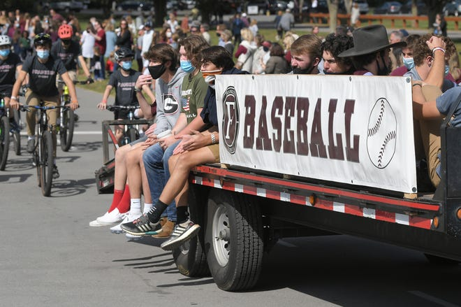 Franklin High School baseball team ride in the school's homecoming parade on campus in Franklin on Friday, Oct 2, 2020.
