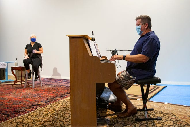 "Suzanne Sole, left, and Dave Gipson rehearse a scene from ""Yours Truly"", Thursday, Oct. 1, 2020, at the Sugden Community Theatre in Naples."