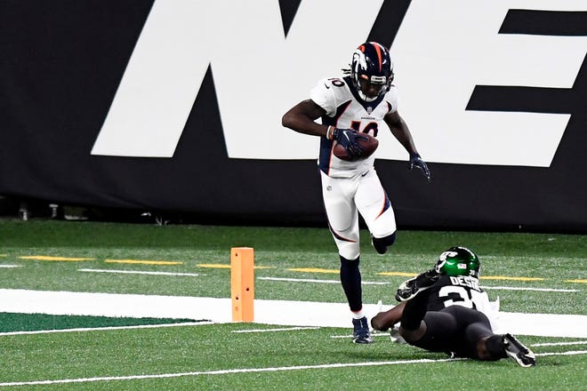 Denver Broncos wide receiver Jerry Jeudy (10) sidesteps New York Jets cornerback Pierre Desir (35) after making a catch for a touchdown in the first half of a NFL game at MetLife Stadium on Thursday, Oct. 1, 2020, in East Rutherford.