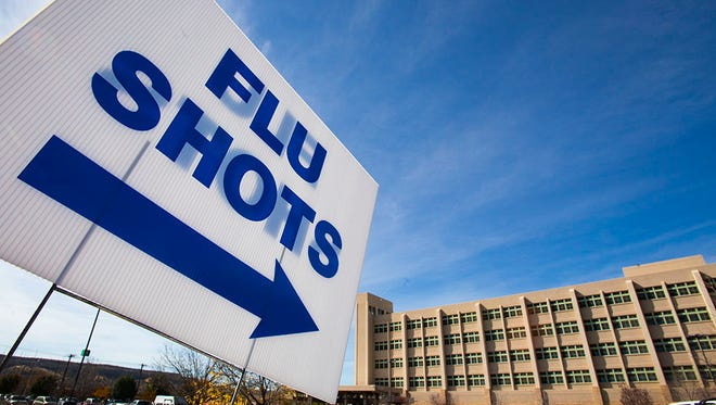 A sign directs drivers to a drive-thru flu shot clinic at San Juan Regional Medical Center last year. The hospital will be offering the clinics again this year on Oct. 24 and Oct. 31.