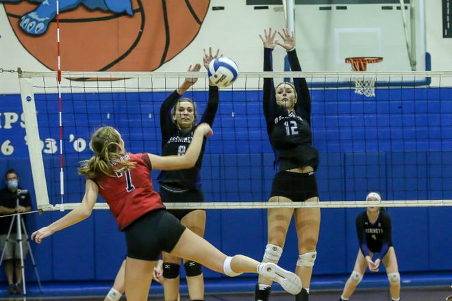 Washington's Emma Klahorst (8) and Jenny Cope (12) block a shot by West Florida Tech's Morgan Higgins (7) during the game at Washington High School on Thursday, October 1, 2020.