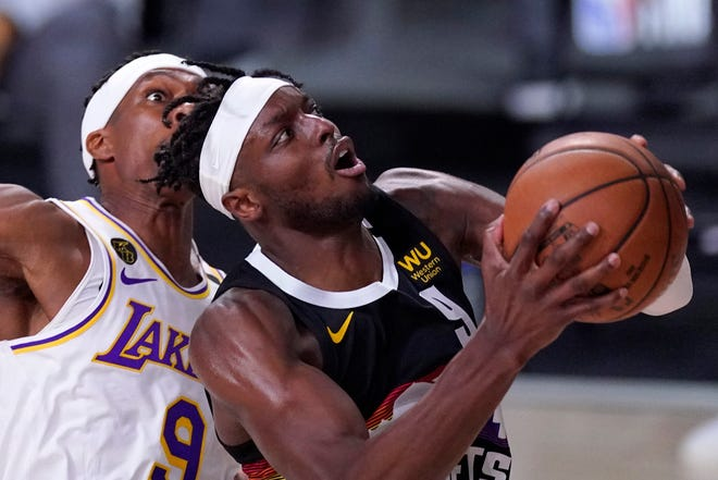 Denver Nuggets forward Jerami Grant (9) goes up for a shot in front of Los Angeles Lakers' Rajon Rondo, left, during the second half of Game 3 of the NBA basketball Western Conference final Tuesday, Sept. 22, 2020, in Lake Buena Vista, Fla. (AP Photo/Mark J. Terrill).