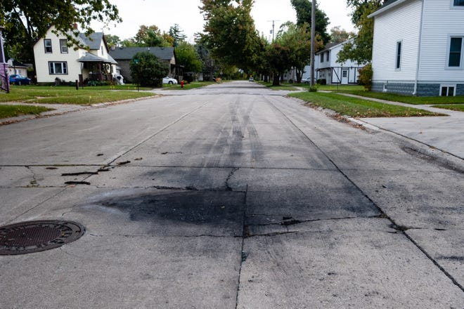 Debris and scorch marks can be seen on Lyon Street Friday morning, Oct. 2, 2020, in Port Huron. An East China man was arrested Thursday night after police said he set a vehicle on fire near the intersection of Lyon and Elk streets.