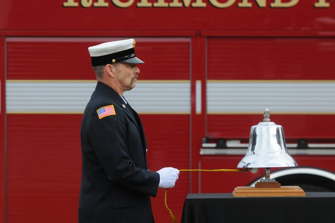 Lt. R.J. Seiple rings the bell in memory of a fallen firefighter during Richmond Fire Department's 50th Memorial Service on Friday, Oct. 2, 2020.