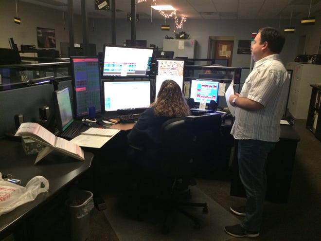 Matthew Cain, director of the Wayne County Emergency Management Agency, consults with Dana Baldwin on Friday, Oct. 2, 2020, inside the Emergency Communications Center.