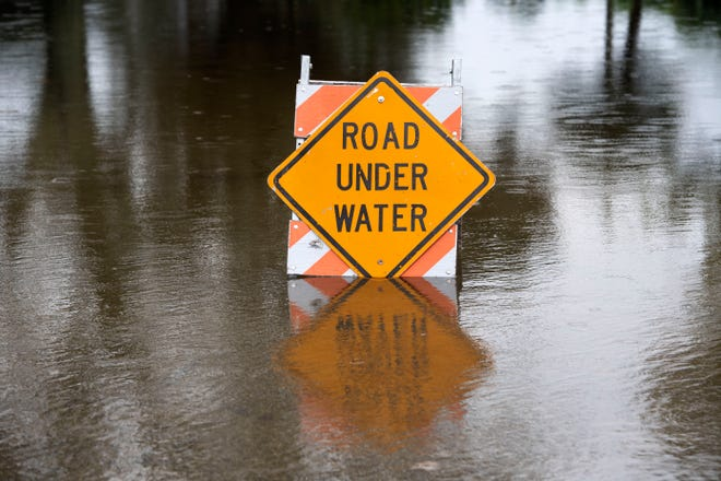 Hobe Sound streets and properties are flooded Friday, Oct. 2, 2020. From Thursday into Friday, 9 inches of rain has fallen in Martin County.