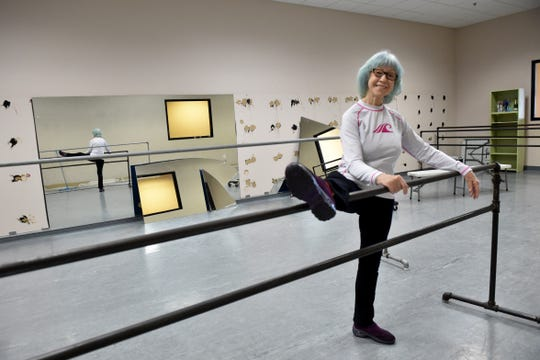 Joy MacKinnon, owner of the MacKinnon Dance Academy in Oxnard, stretches on a bar in her studio on Tuesday, Sept. 29, 2020, as she works to clear out the facility. The academy officially closed after more than four decades due to loss of revenue from COVID-19 restrictions. The energetic 85-year-old insists she's not retiring, though says she doesn't know what will come next.