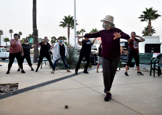 Joy MacKinnon, owner of the MacKinnon Dance Academy in Oxnard, leads her instructors and students in an impromptu farewell dance on Wednesday, Sept. 30, 2020 with music playing from a portable music player as they prepare to close after more than four decades due to loss of revenue from COVID-19 restrictions.