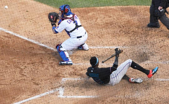 Cubs-Marlins, Game 2: Lewis Brinson slides safely to score a run in the seventh inning.