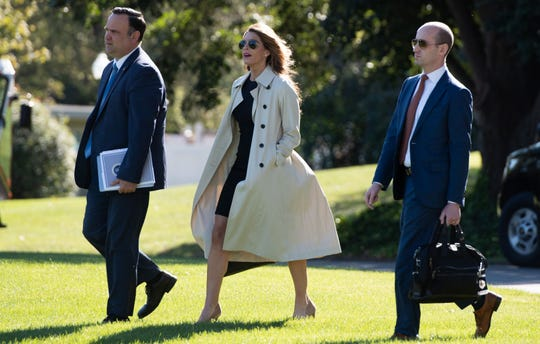 (FILES) In this file photo taken on September 21, 2020 Dan Scavino (L), Director of White House Social Media, Hope Hicks, White House counselor, and Stephen Miller (R), White House senior advisor, walk to Marine One prior to departing with US President Donald Trump.