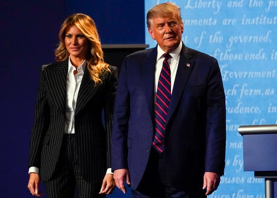 President Donald Trump stands on stage with first lady Melania Trump after the first presidential debate with Democratic presidential candidate Joe Biden.