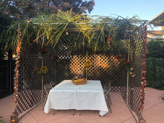 Becky Sobelman-Stern uses palms from an on overgrown tree for the roof of her the sukkah in Sherman Oaks, California.