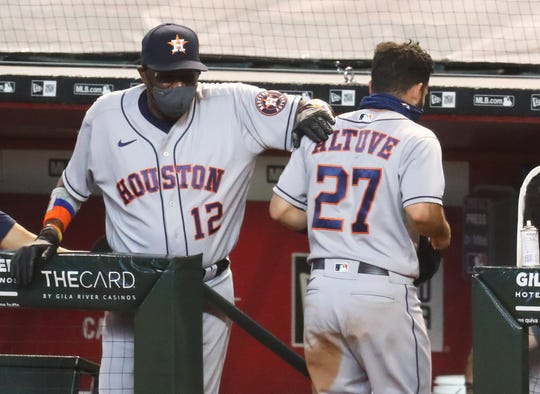 Astros manager Dusty Baker with second baseman Jose Altuve.