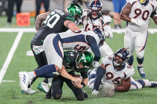 New York Jets quarterback Sam Darnold (14) is sacked by Denver Broncos outside linebacker Bradley Chubb (55) during the first half at MetLife Stadium.