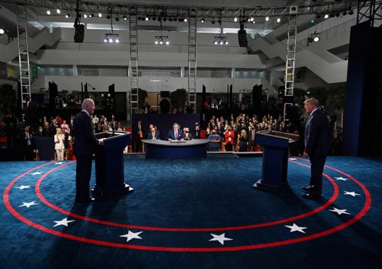 President Donald Trump and Democratic presidential candidate former Vice President Joe Biden arrive for the first presidential debate Tuesday, Sept. 29, 2020, at Case Western University and Cleveland Clinic, in Cleveland.