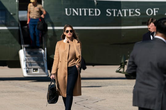 Counselor to the President Hope Hicks walks from Marine One to accompany President Donald Trump aboard Air Force One as he departs Sept. 30, 2020, at Andrews Air Force Base, Md.
