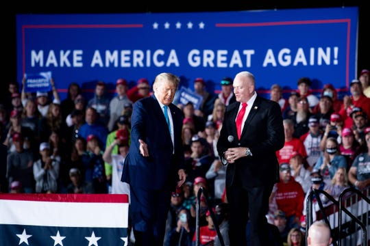 US President Donald Trump and National President of the Fraternal Order of Police Patrick Yoes speak during a