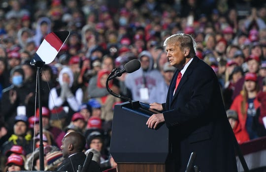 "US President Donald Trump speaks at a ""Make America Great Again"" campaign rally at Duluth International Airport in Duluth, Minnesota, on September 30, 2020."