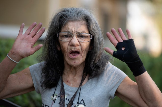 """I'm the master of assassination,"" Lorenza Marrujo, 67, says when asked about her martial arts skills at her Fontana, Calif., apartment home Wednesday, Sept. 30, 2020. Marrujo, who likes to be called ""Lady Ninja"" and has a black belt in ju jitsu, said she was in her third-floor apartment Monday when she heard screams coming from a neighbor's apartment and went to investigate. There, she said, she found another neighbor attacking her 87-year-old friend, Elizabeth McCray. Marrujo came to her rescue. (Cindy Yamanaka/The Orange County Register/SCNG via AP) ORG XMIT: CAANR400"