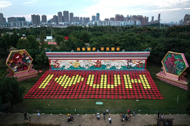 An aerial drone view of a sign reading 'I love Wuhan' made from umbrellas during the Chinese national holiday week.